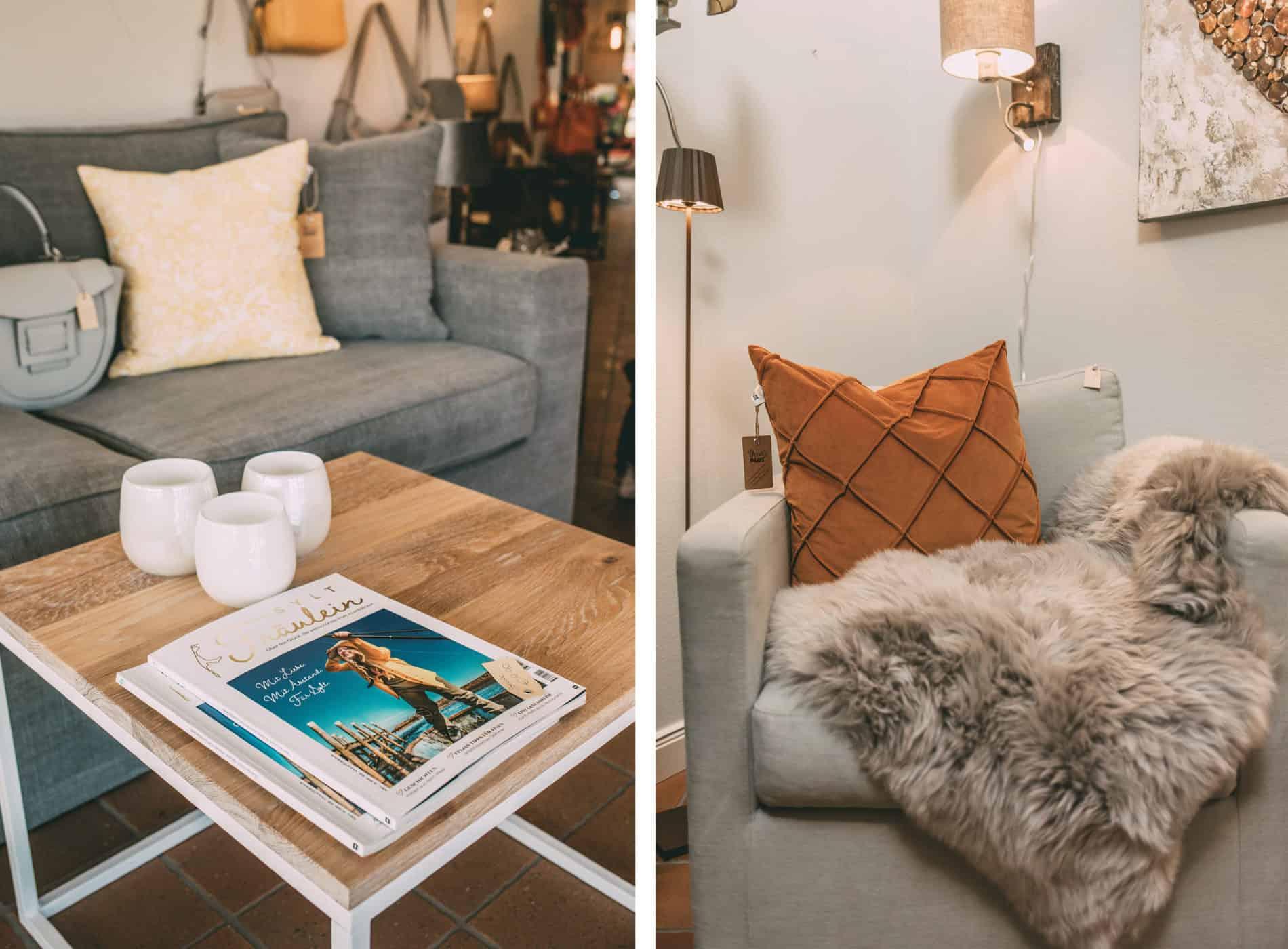 Couchtisch mit Sylt Fräulein Magazin, Sofa mit Kissen und Decke